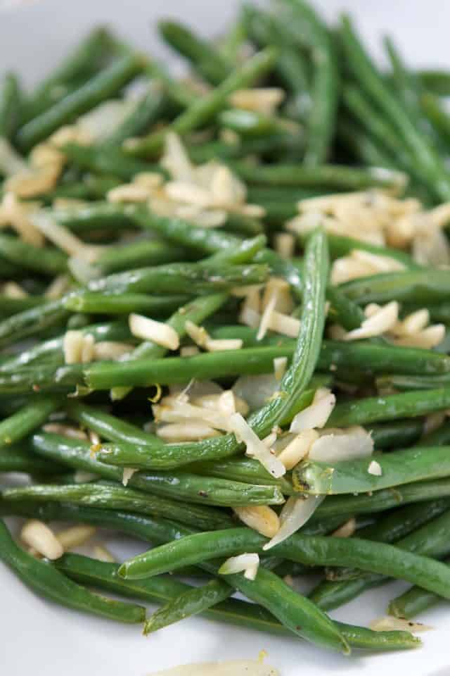 close up of green beans with almonds