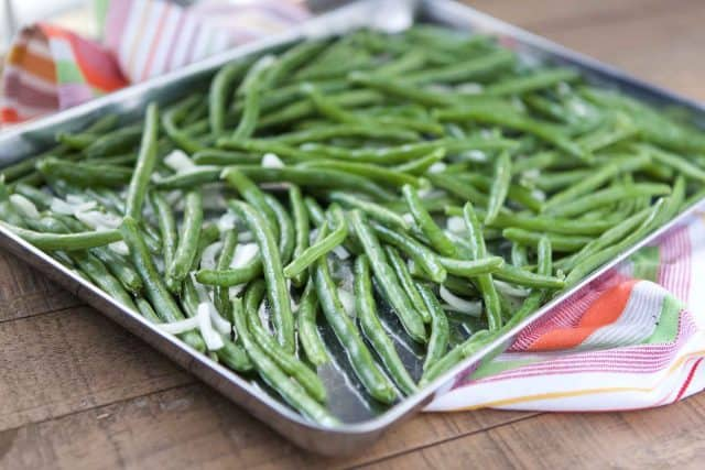 sheet pan of green beans before cooking
